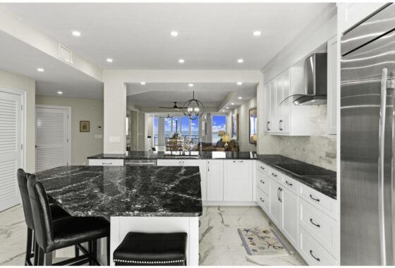 6000 Royal Marco Way 349 Condo For Sale. Kitchen and Bar featured image.